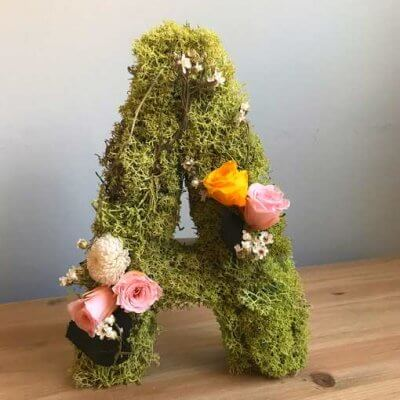 Letras de flores preservadas